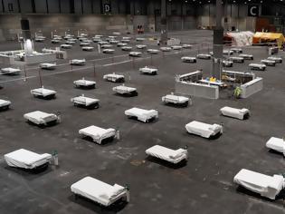 Φωτογραφία για Κορονοϊός - Ο Πλανήτης σε πολιορκία: Γήπεδα, πάρκινγκ, εκθεσιακά κέντρα γίνονται νοσοκομεία