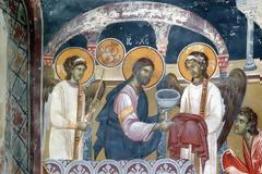 Η Ιερή Λαβίδα και το χείλος του Αγίου Ποτηρίου πυρούνται και καθαίρονται από το πῦρ της θεότητος