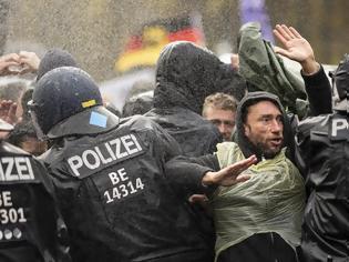 Φωτογραφία για Γερμανία: Ψηφίστηκε η αλλαγή νομοθεσίας για τις πανδημίες - Επεισόδια στο Βερολίνο
