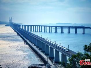 Φωτογραφία για Οδική και Σιδηροδρομική Γέφυρα του Πορθμού Πινγκντάν: η μεγαλύτερη του είδους της στον κόσμο.