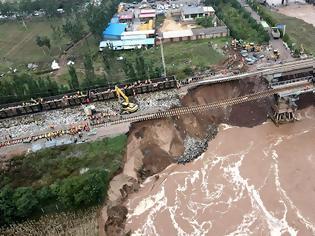 Φωτογραφία για Κίνα: Πλημμύρες προκάλεσαν ζημιές στο σιδηροδρομικό δίκτυο. Εικόνα