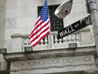 Φωτογραφία για Πτωτική επάνοδος στην Wall Street μετά την ημέρα της Ανεξαρτησίας