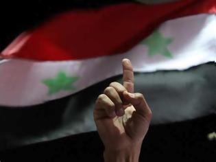 Φωτογραφία για Ανήσυχη η Γαλλία για τις πληροφορίες περί μετακίνησης χημικών όπλων στη Συρία