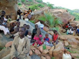 Φωτογραφία για Κάνει καλό ο Κλούνι στο Σουδάν;
