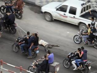 Φωτογραφία για Τον εκτέλεσαν και τον έσυραν στο δρόμο - ΠΡΟΣΟΧΗ! ΠΟΛΥ ΣΚΛΗΡΕΣ ΕΙΚΟΝΕΣ (Vid)