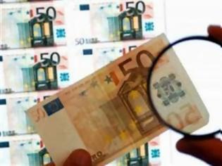 Φωτογραφία για Πώς να καταλάβετε αν ένα χαρτονόμισμα είναι πλαστό