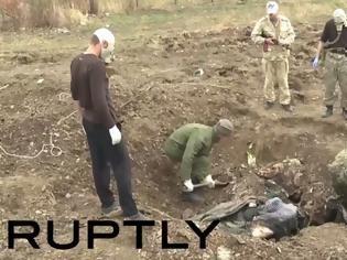 Φωτογραφία για Bρέθηκε και τέταρτος ομαδικός τάφος έξω από το Ντονιέτσκ - Διεθνής καταδίκη για τη βάναυση σφαγή