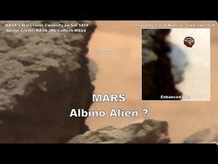 Φωτογραφία για Πρόσωπο εξωγήινου που κρυφοκοιτάζει πίσω από βράχο στον Άρη σε επίσημη εικόνα της NASA, σύμφωνα με ισχυρισμούς (video)